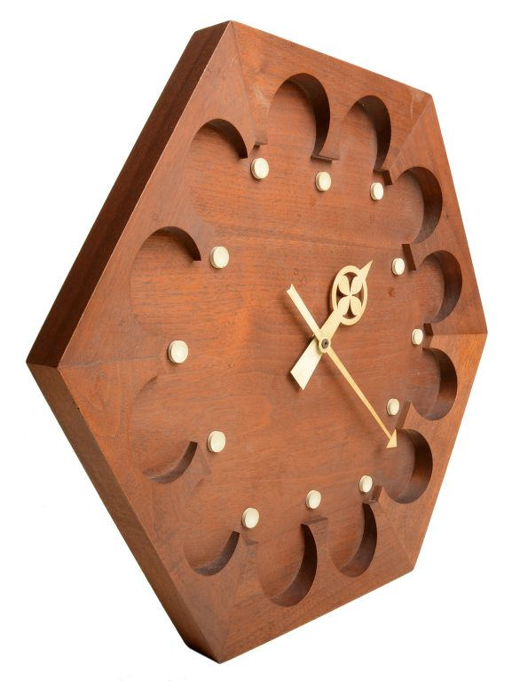 George Nelson; Walnut and Enameled Metal Wall Clock for Howard Miller, 1960s.