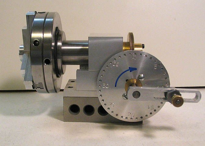 Taig Lathe Dividing Head by Dean Williams -- Homemade dividing head intended for use with a Taig lathe. Main shaft accepts chucks and threaded arbors. Gear ratio is 100:1. Indexing pin can be moved along the indexing arm slot, enabling adjustments to accommodate different indexing plate sizes. Upgraded with new spindle block in order to accept standard lathe spindles with chucks. http://www.homemadetools.net/homemade-taig-lathe-dividing-head