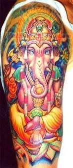 Ganesha Tattoo On Shoulder- another good one with great coloring
