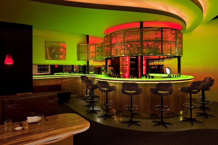 The most striking element of this venue is the combination of Marblo's green and Opal lime used to construct the curvy backlit bar top- both the form and material of this concept was paramount.