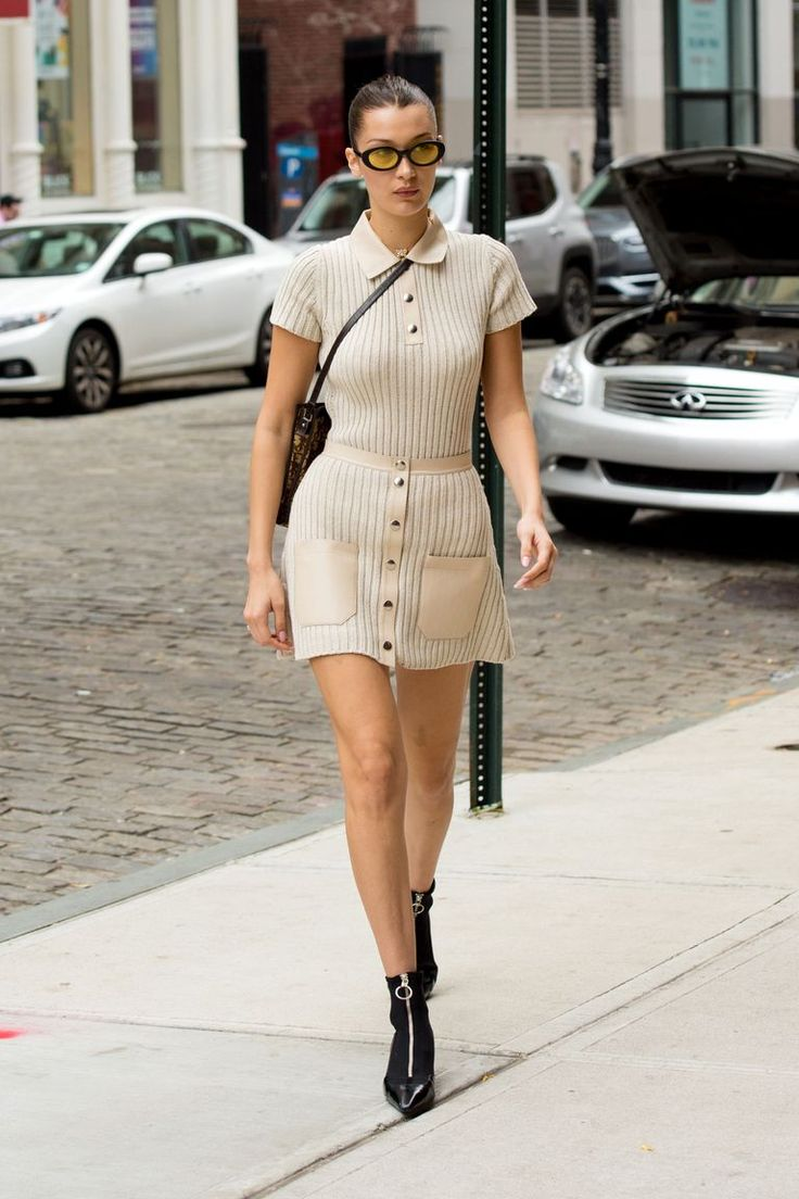 Bella Hadid's Hottest Looks: In a nude ribbed polo and skirt by Alyx, Dior sling bag, pointed-toe zip-up boots, and yellow-tinted sunglasses while out in New York.