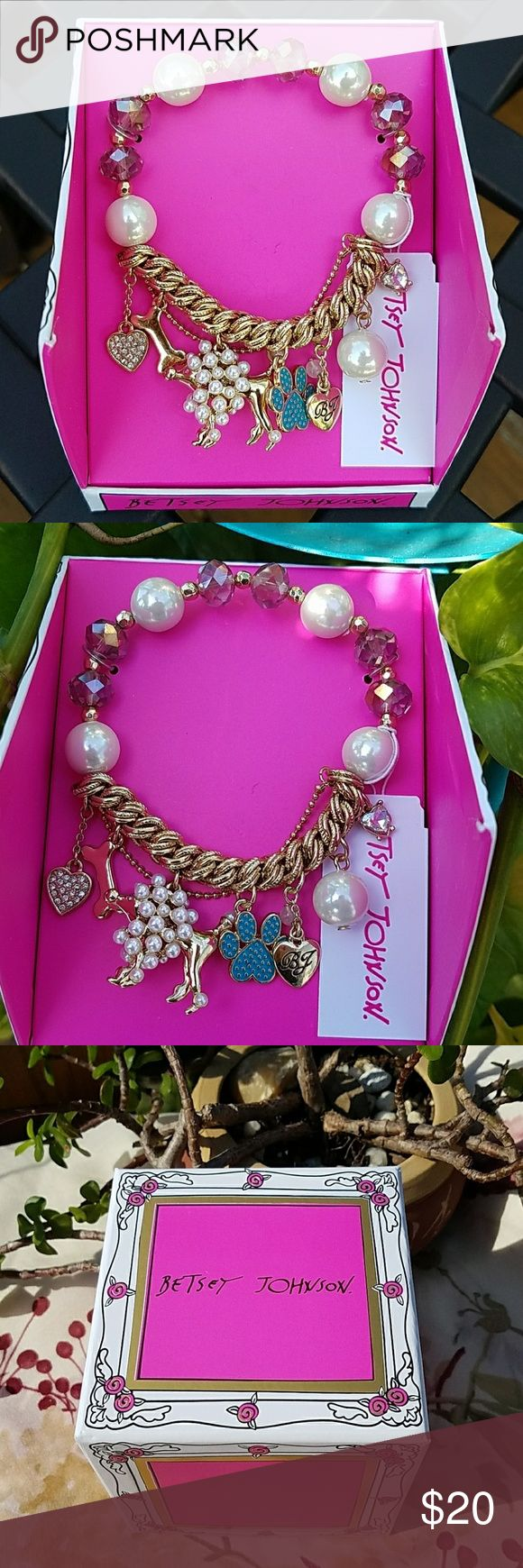 Authentic Betsey Johnson poodle bracelet Betsey Johnson bracelet has pearls and purple beads and a gold chain with a poodle,  bone , puppy paw, rhinestone heart  and  a heart with Betsey Johnson logo. This is authentic bracelet and new comes with a nice gift box. Just think Christmas is  creeping up on us. Betsey Johnson Jewelry Bracelets