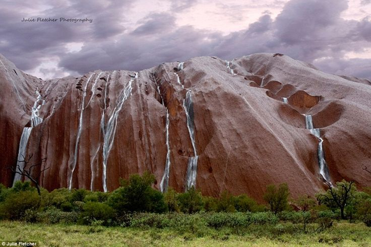 Cascades: Uluru in the Northern Territory gets a makeover when there's heavy rain in the area, and rivers can be seen gushing down the crevices of the red rock