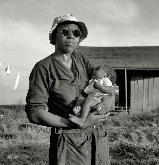 Aldridge Plantation, 1937. Wife and child of tractor driver. I love her sunglasses.