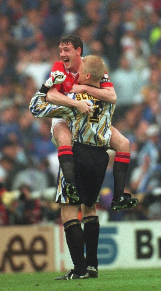 Bruce and Schmeichel celebrate winning the 1994 FA Cup final.