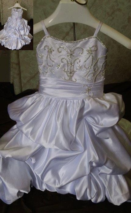 c94b4f2a8b450 This charming infant miniature wedding gown has beaded embroidered bodice,  and pickup skirt. Made in infant size 18 months.