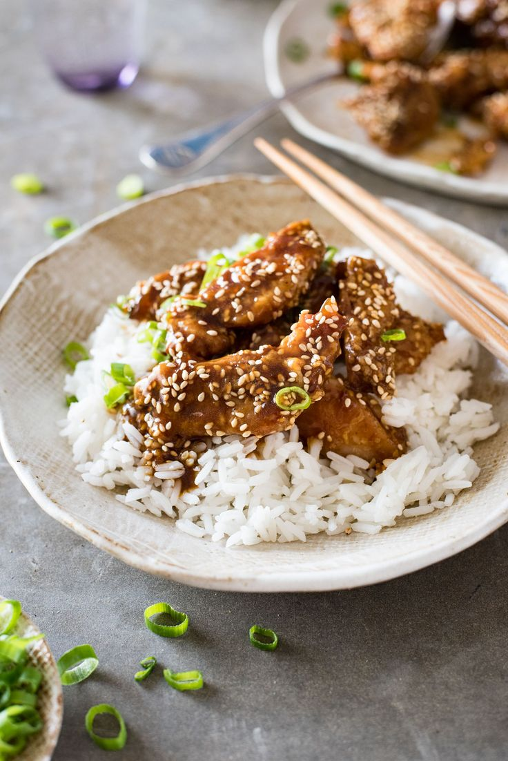 Easy crispy oven baked Chinese Chicken tossed in a sticky honey sesame sauce…
