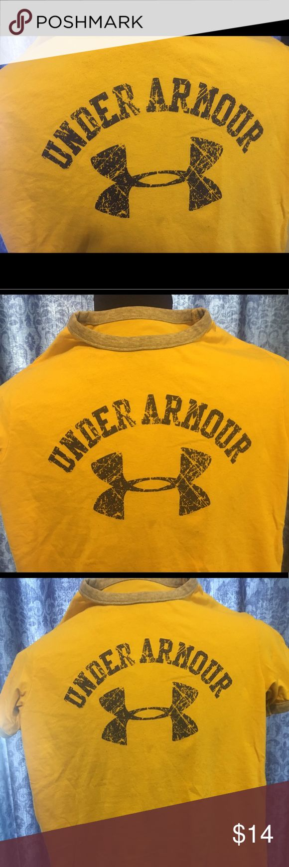 Yellow Kids Under Armour T-Shirt Kids Under Armor t-shirt. Gold with gray neck and arm bands. Purple logo screen printed on the front and back of the shirt. Under Armour Shirts & Tops Tees - Short Sleeve