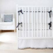 A Shade of Grey Cot Bedding - Not sure if you're having a boy or a girl? Our Shade of Grey Cot Bedding is a classic. This beautiful custom made designer baby bedding set is created with your baby's comfort as well as style in mind.The fabrics are carefully hand picked to coordinate with your nursery, also available in other styles and designs. The price shown is for a 3 sided half bumper and reversible blanket. The fitted cot sheet, cot valance, cushions, curtains and window treatments can…