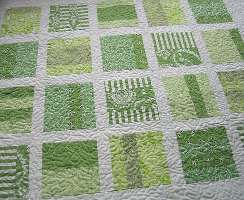 Really simple way to use charms and shake up a simple block quilt. I likey.
