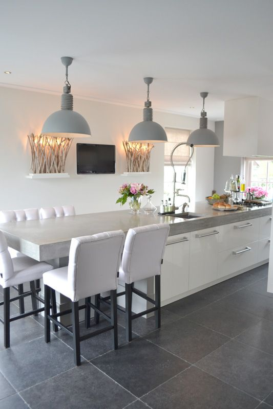 #Kitchen - #Contemporary kitchen with a long island & seating.  #Love the soft grey metal shaded pendant light fixtures....great focal point.