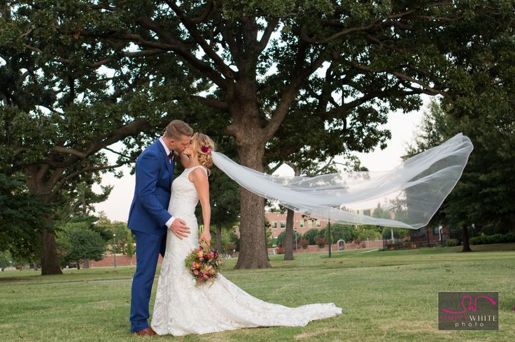 Gorgeous wedding veil blowing in the wind shot, at centennial park in downtown tulsa, oklahoma.