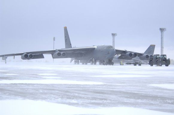 A B-52H at Minot Air Force Base in North Dakota waits to be prepared for flight.