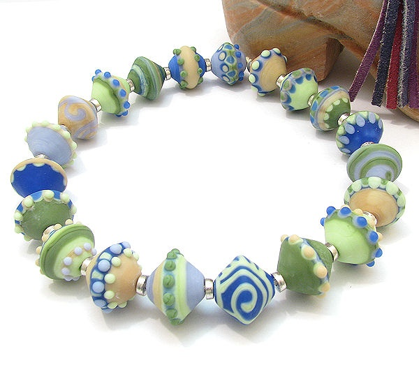 clo handmade glass lampwork beads french pottery bicones blue lavender green