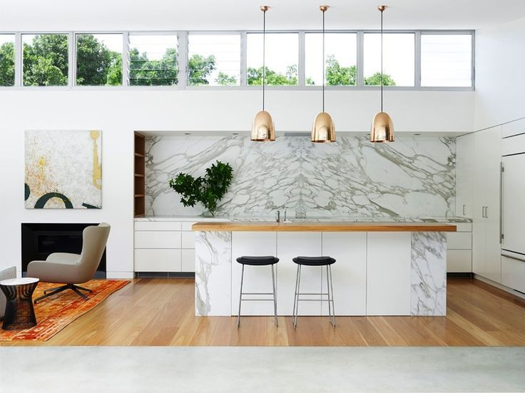Pavilion House by Arent&Pyke - white kitchen + marble backsplash + gold pendants