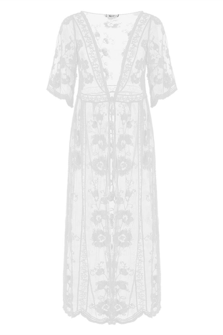 Διάφανη ζακέτα με δαντέλα με κέντημα.Ύψος μοντέλου: 1,80m65% Polyester 35% Cotton