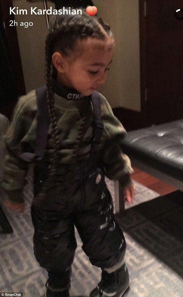 New look: North West, two, has got hair extensions so that she now has waist-length braids, as revealed on her mother Kim Kardashian's SnapChat on Wednesday
