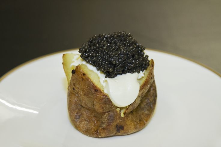 Baked potatoes with soured cream and caviar