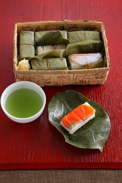 Kakinoha sushi (Pressed sushi) - sliced mackerel, salmon and small snapper on top of rice, wrapped in leaves of kaki fruit