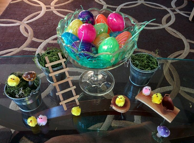 Spring & Easter Decor : Moss with plastic eggs, little miniature garden benches top it off with the always adorable chenille peeps!