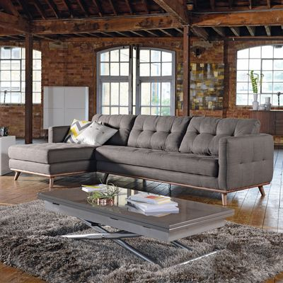 Our Marseille designer sofa offers a soft elegant look with its contrasting grey fabric and walnut. The slightly splayed legs of the platform base has a mild retro feel which when combined with the stitch detail on the sides and cushions give it a contemporary look. The linen/cotton mix fabric offers both softness and durability.  The covers on are the cushions are fixed.  The range is offered in a corner, three or two seater sofa as well as an armchair and a smart footstool.