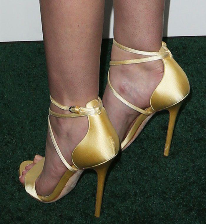 """Dakota Fanning wearing yellow satin """"Tamara"""" sandals by Brian Atwood"""