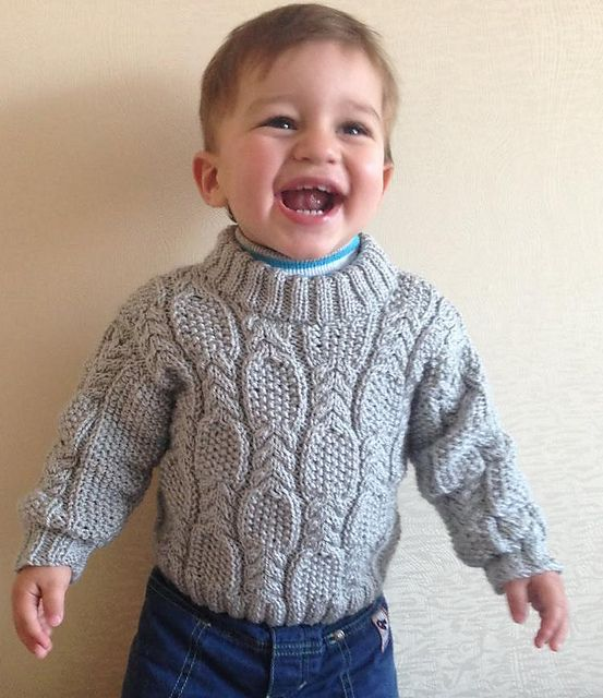 Ravelry: Cable & Seed Stitch Sweater pattern by Nelya Koval.  Free pattern for 12-18 months, sport weight.