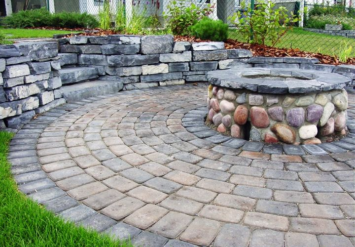 This fire source was created to suit the custom nature of this outdoor space. The client was looking for a large area for entertaining throughout the year. This fire pit provided the perfect piece to finish their backyard. #firesource #outdoordesign #landscaping