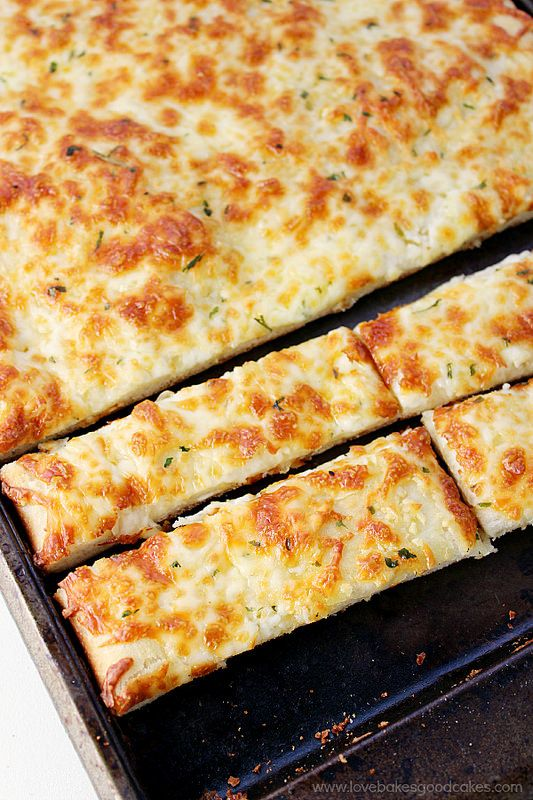 Easy and made from scratch Cheesy Breadsticks like your favorite pizza joint! Recipe includes step by step instructions with photos! Cooking with yeast doesn't have to be intimidating! #FleischmannsYeast #ad : lovebakesgoodcakes.com