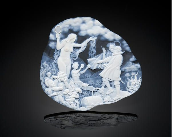 "Impressive Two-color Agate Cameo Depicting the Damnation of Faust--""Walpurgisnacht"" By Dieter and Andreas Roth Idar-Oberstein, Germany  The present museum-quality large cameo of two-color translucent Brazilian agate, depicts the ""Walpurgisnacht"" scene from Goethe's story of Faust, Part I."