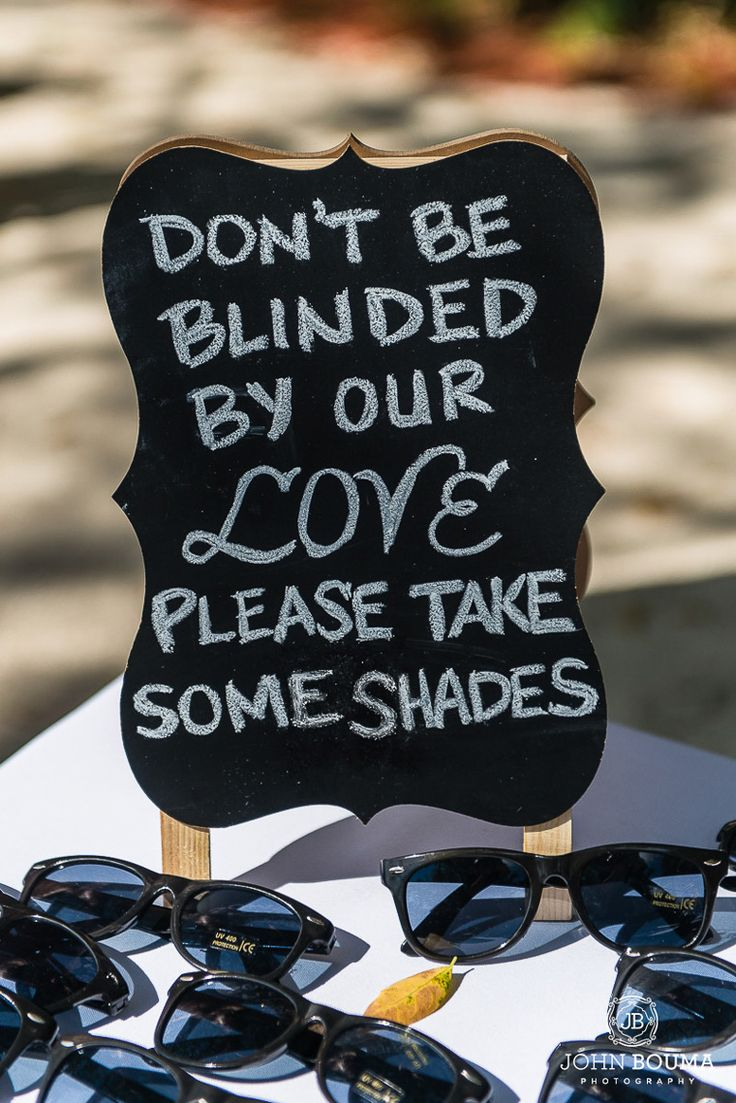 Great idea to offer your  guests sun shades on a bright day at Key Largo Lighthouse Beach Wedding Venue in the Florida Keys