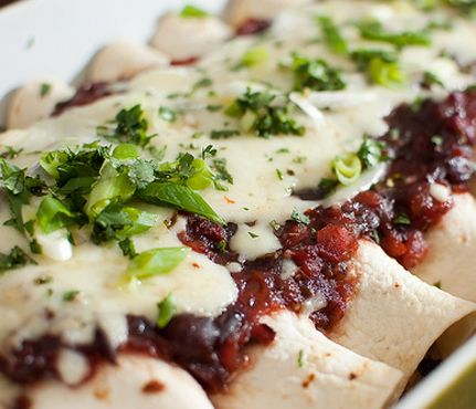Turkey Recipes You've Never Tried: Turkey Cran-Chiladas. Step up your post-Thanksgiving game with this twist on enchiladas. The filling--turkey, cranberries, black beans, onions, cheese and salsa--gets rolled into tortillas, then topped with cranberry sauce, sweet salsa and cheese. #SelfMagazine