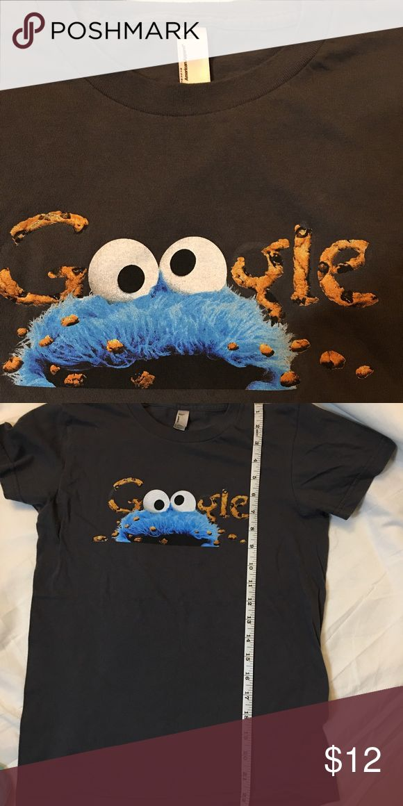 American apparel medium Cookie Monster tshirt🍪 Gently used tshirt. Cookie Monster is eating the letters. This item is fitted like a small. Make your offer🍪 American Apparel Tops