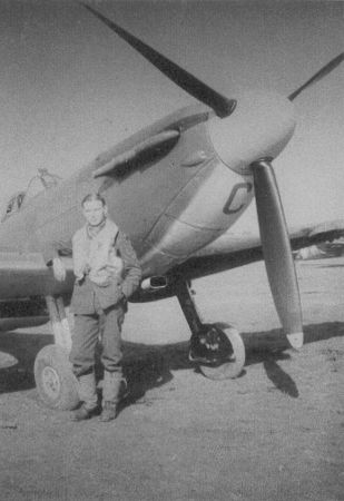 "Sgt John S Anderson of No 152 Squadron RAF poses with Spitfire Mk II UM-C at RAF Warmwell in 1940. Arriving at the airfield on 29 September, the 19-year-old pilot began combat training on 2 October. Damaging the undercarriage on landing on 14 October, he went round again on his second landing, when the weakened landing gear collapsed resulting in a slide along the turf. The ""slight miscalculation"" earned him a logbook endorsement from station commander W/C George Howard."