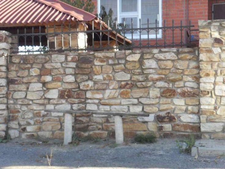 a Fence made of quarry stone
