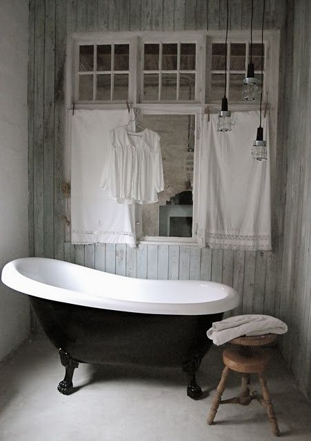IDEA :: Paint the base of a vintage claw foot tub black. (Love the trio of pendants too!)