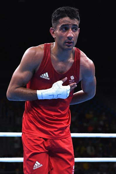 #RIO2016 Qais Ashfaq of Great Britain salutes as he competes in the Men's Bantam preliminary round fight on Day 5 of the Rio 2016 Olympic Games at Riocentro...