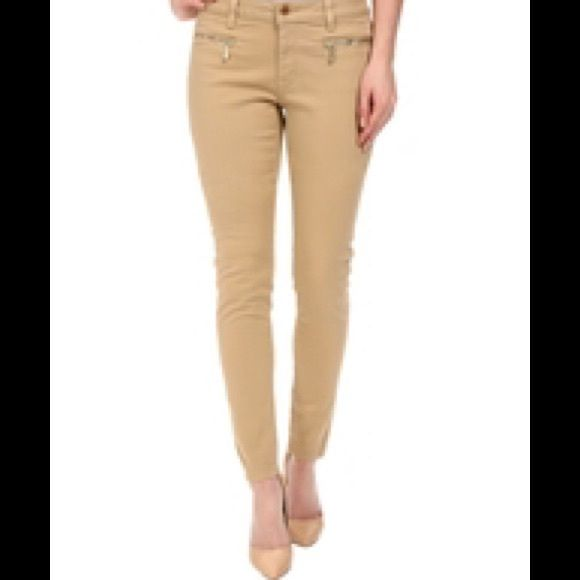 Micheal kors kaki skinny pant Chic style comes easy in these MICHAEL Michael Kors denim skinnies.Pants boast a regular rise and a skinny fit from hip to hem.Khaki is a classic beige colorway that adds sophisticated style to any ensemble.Belt loop waist band.Zipper fly with button closure.Front zippered hand pockets.Flat back pockets with brand plate in upper right corner.98% cotton, 2% elastane.Machine wash cold, tumble dry low.Imported. Size 2p MICHAEL Michael Kors Pants Ankle & Cropped