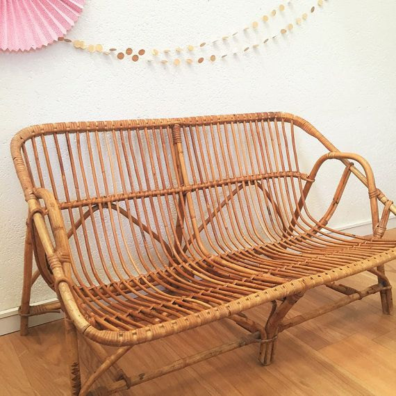 Retro and romantic look for this beautiful rattan sofa 2 places, typical of the 60s,  We love the delicacy work rattan, straw-colored patina &