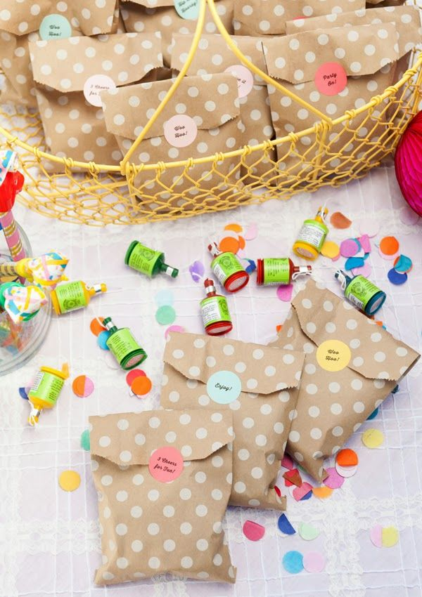"Confetti Birthday Party Favors -  fill kraft paper treat bags with playdoh, bouncy balls, mardi gras beads, bubbles, poppers and a 'party animal' blower... and of course, some extra confetti for a surprise (ie: mess) at home. Label them with phrases like ""woo-hoo"", ""hip hip hooray"", ""party on""and ""3 cheers for fun""."