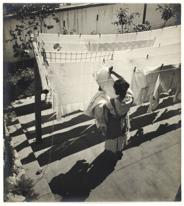 Alexander Rodchenko  [Woman hanging laundry on clothesline]