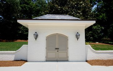 """The colors are """"Brandon Beige"""" for the doors, and """"Ballet White"""" for the brick and trim. They are bt Benjamin Moore."""
