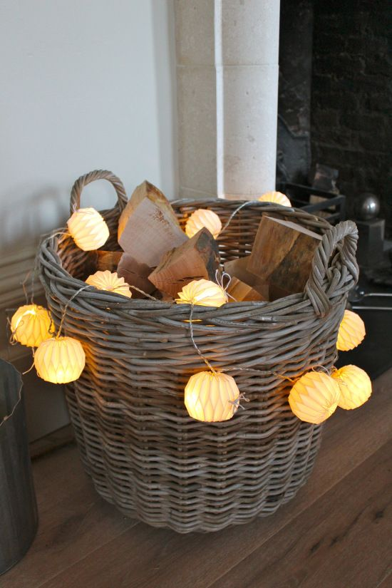 log basket with a garland of Japanese origami paper lights - so simple and festive