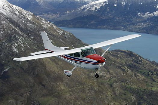 Cessna 172 and Mountains  Wakatipu Aero Club specialises in mountain flying training. Here, one of its C172s flies over rugged mountainous terrain on the shores of Lake Wakatipu not far from its home base of Queenstown, New Zealand. Part of Lake Wakatipu visible in the background.