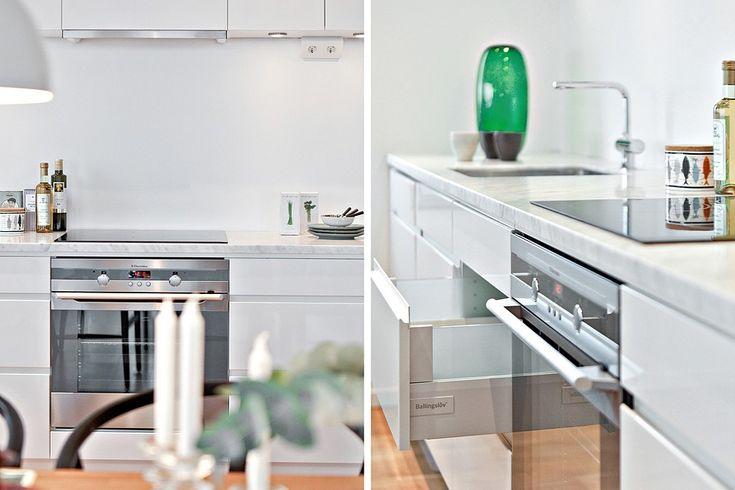 Smakfull köksinredning från Ballingslöv och vacker bänkskiva i marmor