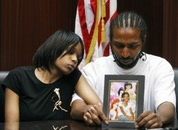 FILE - In this  May 18, 2010 file photo, Dominika Stanley, left, the mother of 7-year-old Aiyana Jones, sits next to Aiyana's father Charles Jones, who holds a photo of her in Southfield, Mich. A warrant request seeking the arrest of an unnamed man in connection with last May's shooting death of 7-year-old Aiyana Stanley-Jones by a member of the Detroit police Special Response Team is being reviewed, the Wayne County prosecutor's office said. The warrant request was submitted Thursday,