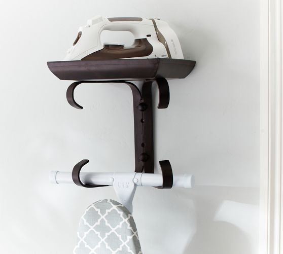 Simple and clever storage for an iron and ironing board. Ironing Board Hanger | Pottery Barn