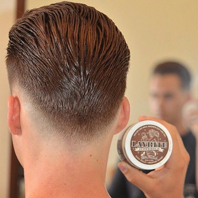 Great back view of an extreme low and tight with a slick back crafted by @iranthebarber. Nicely tapered and dressed with Layrite Super Hold for the finish. WWW.LAYRITE.COM