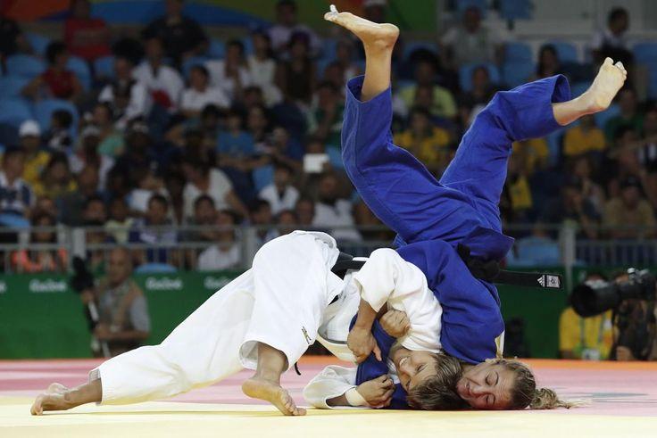 Russia's Natalia Kuziutina (white) competes with Canada's Ecaterina Guica during…