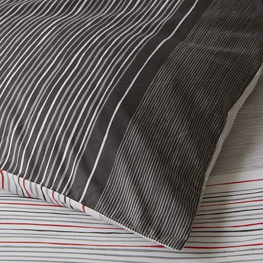 The reversible Skinny Mini Stripe Duvet Cover + Shams mixes light and dark stripes. Pair it with crisp white sheets and solid accent pillows for a classic look.